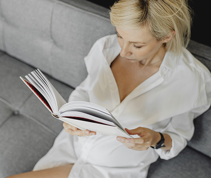 Pregnant lady reading a book