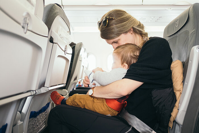 Mum and baby sitting on plane