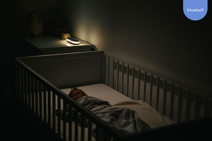 Baby sleeping with their night light from their Bluebell Smart baby monitor