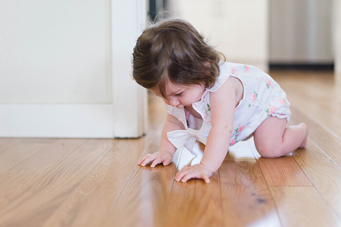 Baby exercising by crawling around on the floor