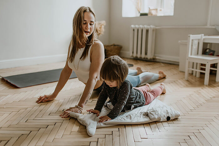 Mum and daughter doing family exercise / yoga