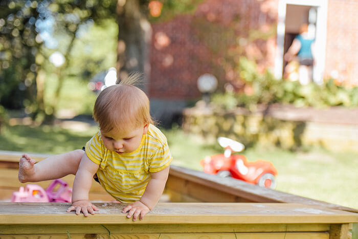 Baby playing in the garden